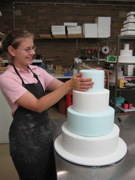 Placing top layer snowflake cake - Talk Sweet To Me
