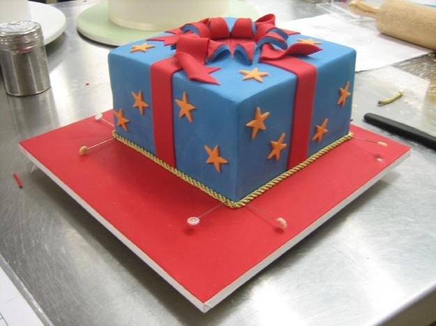 Placing rope around cake base - Talk Sweet to Me