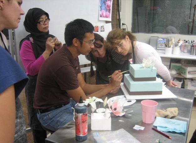 Handi demonstrating cake painting - Talk Sweet to Me
