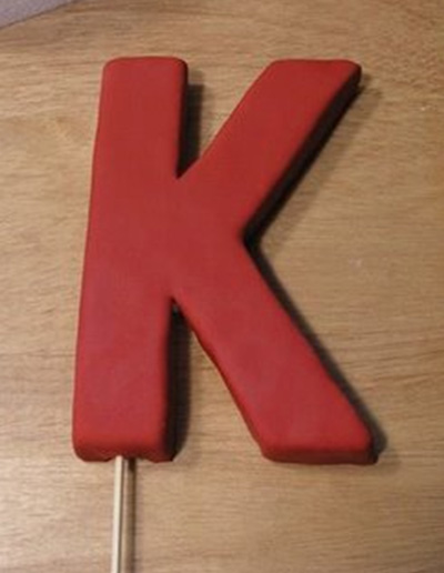 Red K initial cake topper